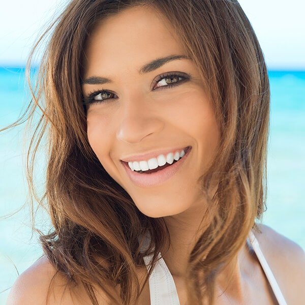 A young woman smiling on the beach