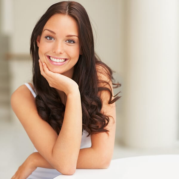 A young woman with beautiful smile smiling